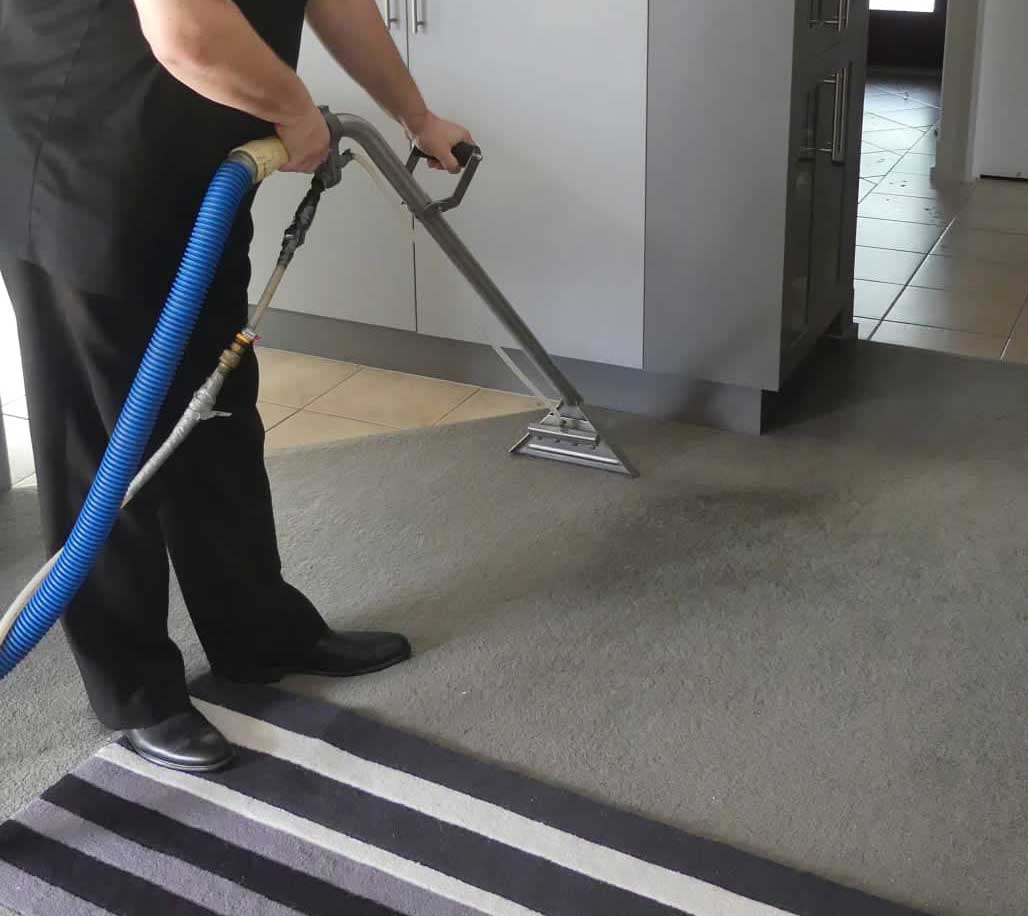 carpet-cleaning man & wand